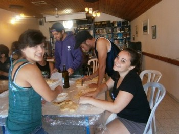Josh (purple jacket) making challah at Livnot