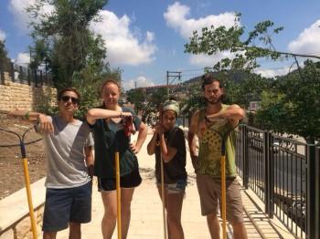volunteers building community garden