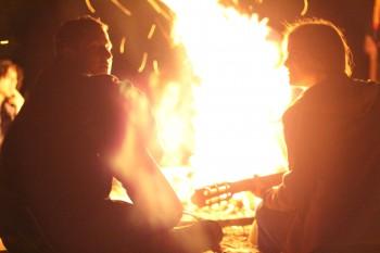 Singing at campfire while hiking
